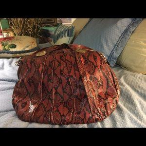 Gucci Red Snake Skin handbag with shoulder strap.